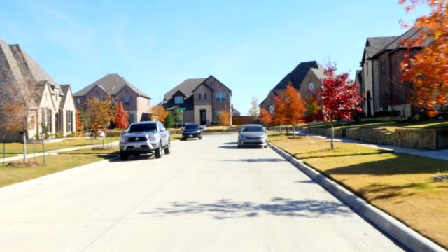 front view driving through residential houses in suburban estate street - driveway stock videos & royalty-free footage