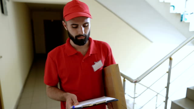 front view footage of delivery person ringing on the doorbell - postal worker stock videos & royalty-free footage