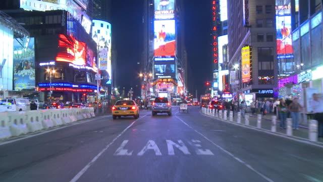 pov front view from car driving down broadway in time square / new york city, new york, united states - påle bildbanksvideor och videomaterial från bakom kulisserna