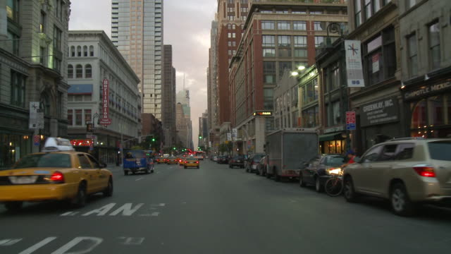 pov front view from car driving with traffic on 5th avenue south and 6th avenue north / new york city, new york, united states - fifth avenue stock-videos und b-roll-filmmaterial