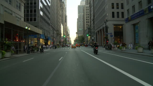 POV Front view from car stopping at intersection in the business district / New York City, New York, United States
