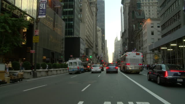 POV Front view from car turning a corner in the business district / New York City, New York, United States