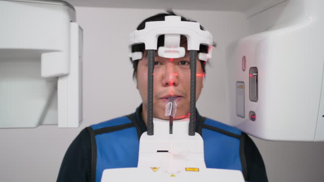front view of asian man in x-ray room in dental clinic. he got x-ray on his teeth - human teeth stock videos & royalty-free footage