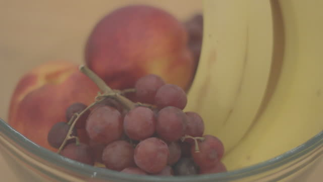 front view of assorted fruit in a bowl - fruit bowl stock videos & royalty-free footage