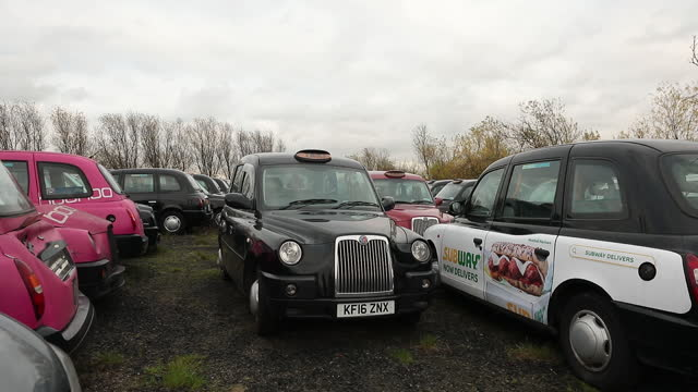 front view of black taxi stored in epping forest amid covid-19 lockdown. black cabs stored in epping forest field after coronavirus lockdown forces... - front view stock videos & royalty-free footage