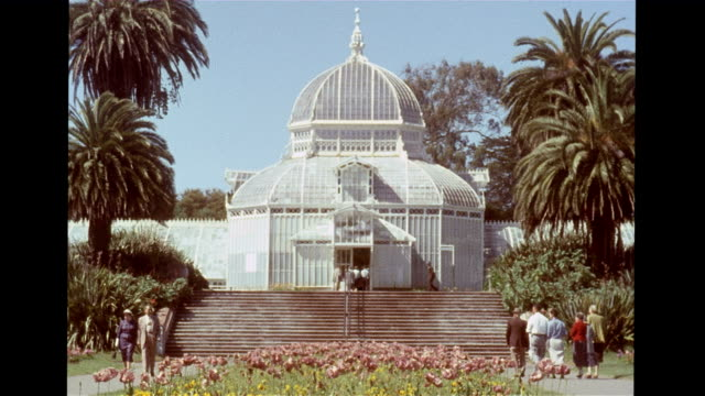/ front view of conservatory of flowers at golden gate park / woman talking to police officer on a horse / field of poppies on the lawn / cu various... - haight ashbury stock videos & royalty-free footage