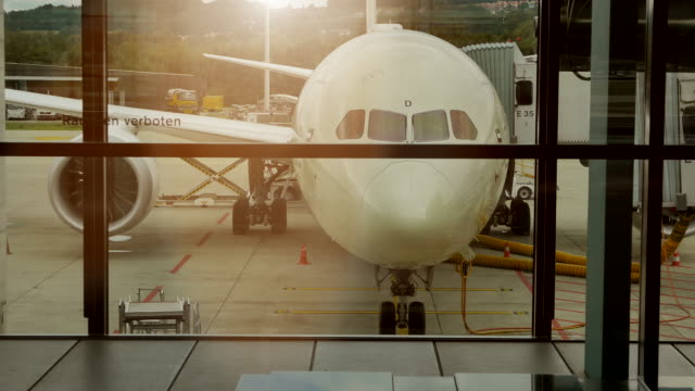 front view of large airplane at airport terminal. business travel background