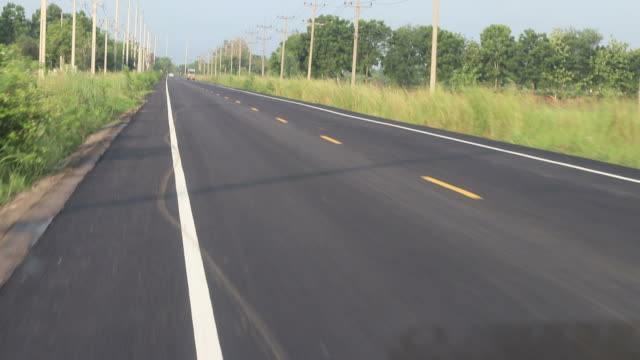 front view of rural paved road. - middle of the road stock videos & royalty-free footage