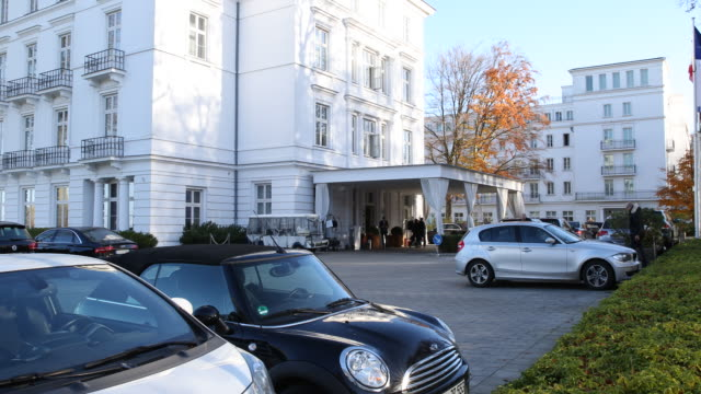 a front view of the buildings of the grand hotel heiligendamm complex at the baltic sea on a sunny autumn day also known as weiße perle heiligendamm... - g8 stock-videos und b-roll-filmmaterial