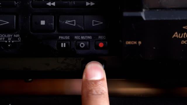 vídeos de stock e filmes b-roll de front view: opening cassette  stereo player on the bottom - vista de baixo para cima