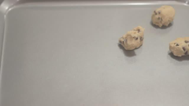 front view placing cookie dough on baking sheet - baking sheet stock videos & royalty-free footage