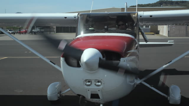 cu front view propeller of small plane starting / novato, california, usa - propeller stock videos & royalty-free footage