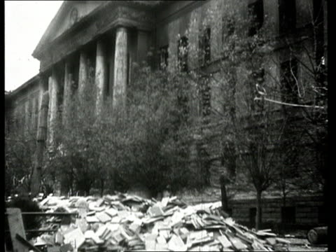 MS Front wall of building collapsing on street in Novorossikysk Russia/ WS TD Exterior of ruined university building with large pile of books lying...