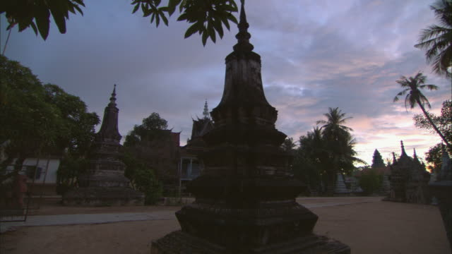 ms, pan, front yard of theravada buddhist monastery at dusk, siem reap, cambodia - cambodian culture stock videos and b-roll footage