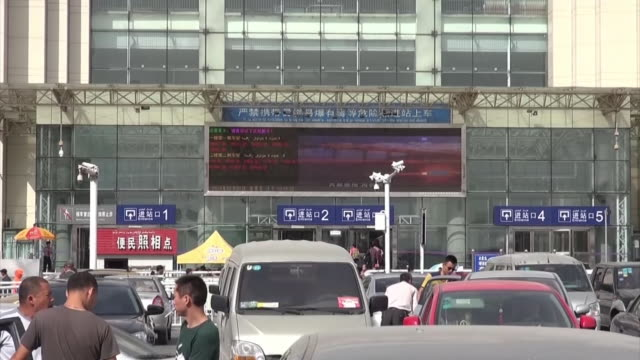 Frontal exterior view of Urumqi station where an explosion ocurred in 2014 April Tilting down from the station sign down to the car park outside the...