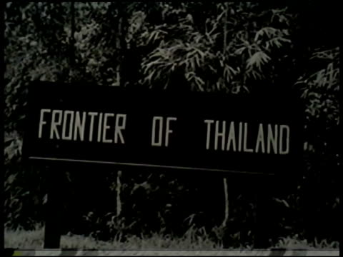 frontier of thailand' sign, japanese soldiers walking under architectural arch in southeast asia, soldiers in suspenders & short sleeve shirts... - sleeve stock videos & royalty-free footage