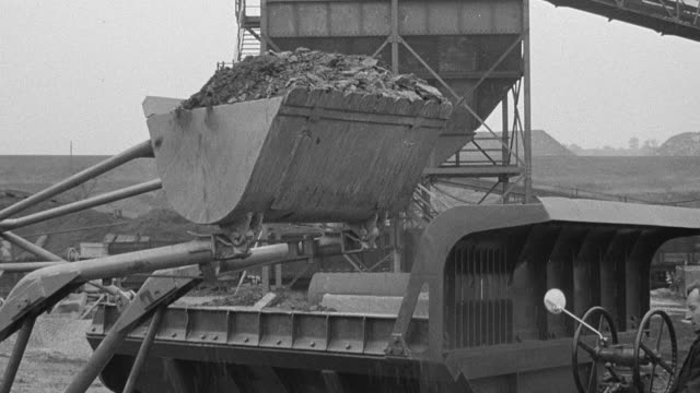 1954 b/w front-loader dumping dirt into dump truck during performance trials / arkwright, england, united kingdom - 1954 stock videos & royalty-free footage