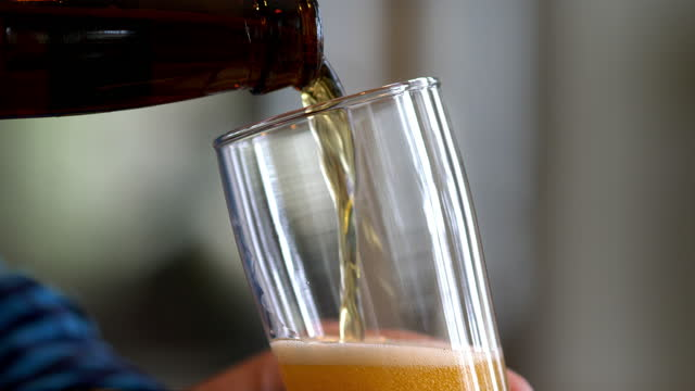 a frosty mug glass of beer being poured. - beer bottle stock videos & royalty-free footage