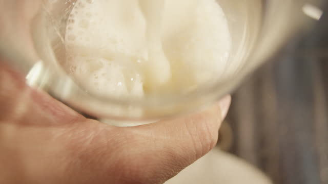 froth and bubbles form in beer - frothy drink stock videos & royalty-free footage