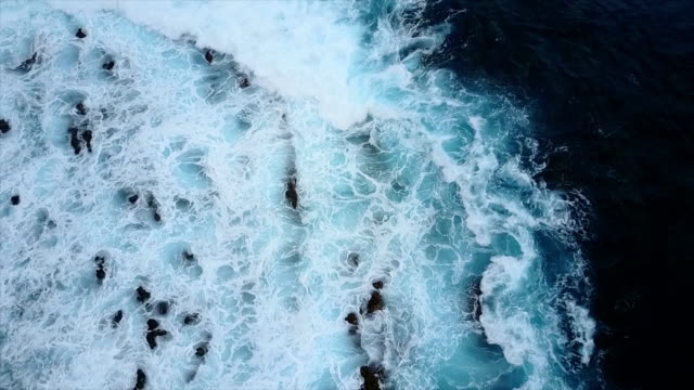 Frothy Waves Crashing Over Rocky Shore on Maui