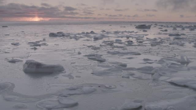 frozen arctic coast, canada - frozen stock videos & royalty-free footage