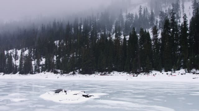 frozen caples lake in the sierras - frozen stock videos and b-roll footage