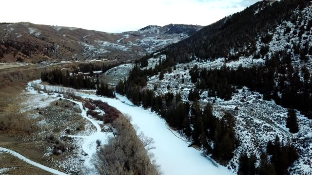 frozen colorado river in snowy rocky mountains - river colorado stock videos & royalty-free footage