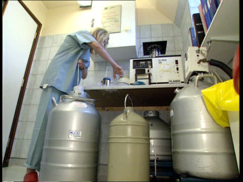 frozen embryos destroyed england london churchill clinic embryo storage containers in drum of liquid nitrogen as one phial removed la ms embryologist... - liquid solution stock videos and b-roll footage