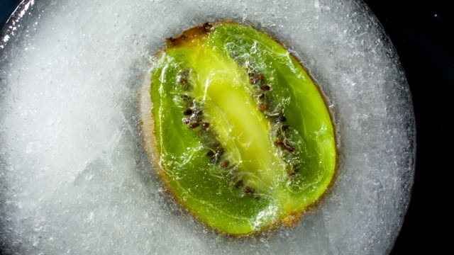 frozen kiwi in ice cube - tropical fruit stock videos & royalty-free footage