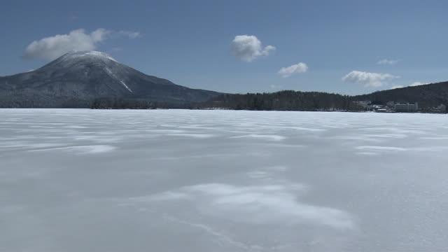 pov; frozen lake akan and mt oakan, hokkaido, japan - hokkaido stock videos & royalty-free footage