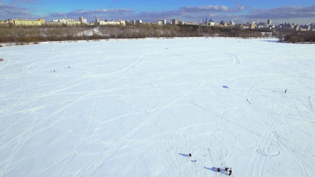 Frozen lake and ice fishing - aerial view
