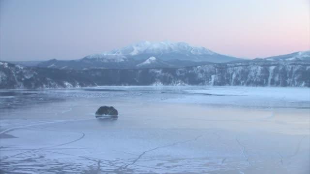 frozen lake at dawn, hokkaido, japan - hokkaido stock videos & royalty-free footage