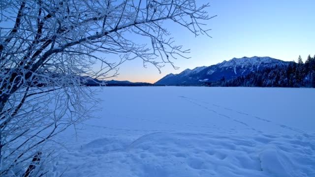 frozen lake barmsee on morning in winter, krün, garmisch-partenkirchen upper bavaria, bavaria, germany, european alps - krün stock videos and b-roll footage