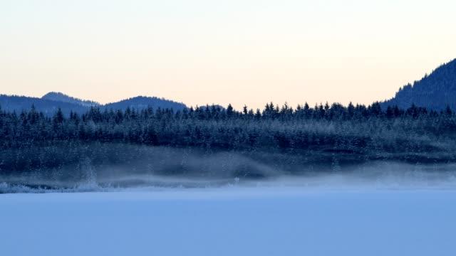 frozen lake barmsee on morning with pulling fog in winter, krün, garmisch-partenkirchen upper bavaria, bavaria, germany, european alps - krün stock videos and b-roll footage