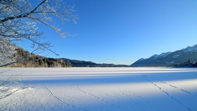 frozen lake barmsee with karwendel mountainrange on morning in winter, krün, garmisch-partenkirchen upper bavaria, bavaria, germany, european alps - krün stock videos and b-roll footage