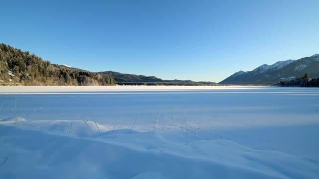 frozen lake barmsee with karwendel mountainrange on morning in winter, krün, garmisch-partenkirchen upper bavaria, bavaria, germany, european alps - frozen stock videos and b-roll footage