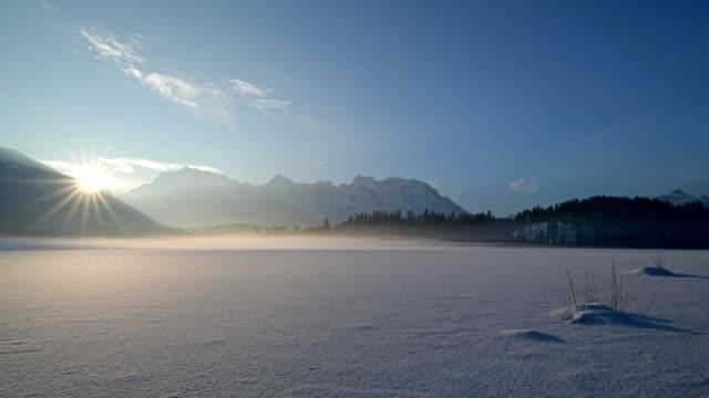 Frozen lake Barmsee with Karwendel mountainrange on morning with sun in winter, Krün, Garmisch-Partenkirchen Upper Bavaria, Bavaria, Germany, European Alps