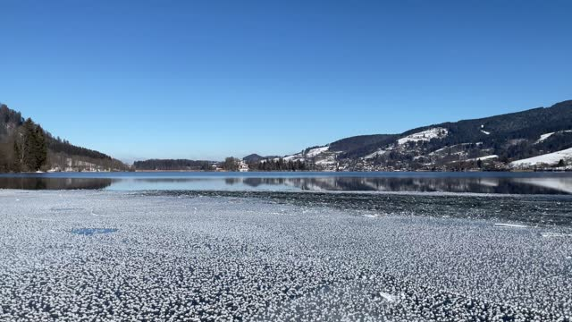 frozen lake schliersee - bavarian alps stock videos & royalty-free footage