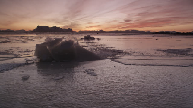 frozen landscape and sea ice at dawn, arctic norway - ice stock videos & royalty-free footage