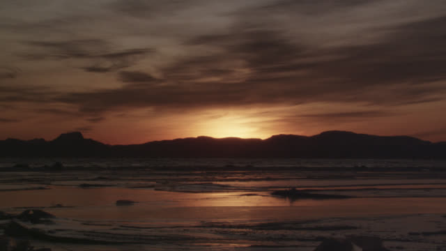 frozen landscape and sea ice at dawn, norway - orange colour stock videos & royalty-free footage