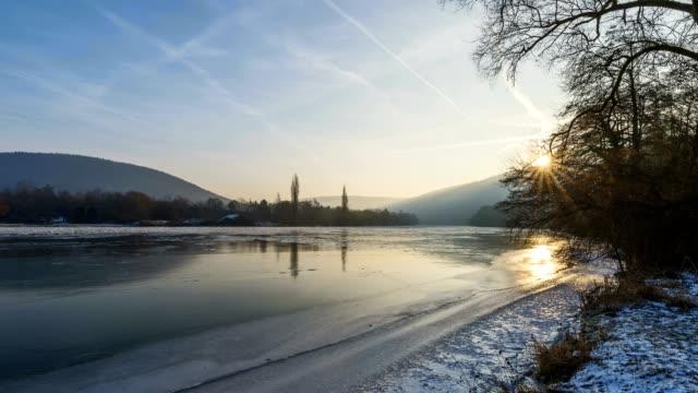 frozen river main in winter at sunrise, bestenheid, wertheim, spessart, mainfranken, franconia, baden wurttemberg, germany - 30 seconds or greater stock videos & royalty-free footage