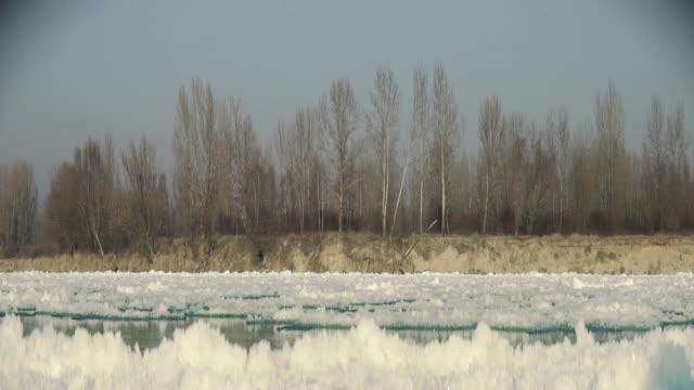 Frozen river starting to thaw