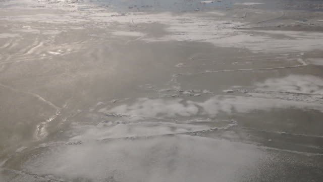 frozen sea water seen from a boat in quebec / canada - frozen water stock videos & royalty-free footage