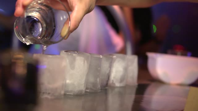 frozen shot glasses served with alcohol in a nightclub - frozen stock videos & royalty-free footage