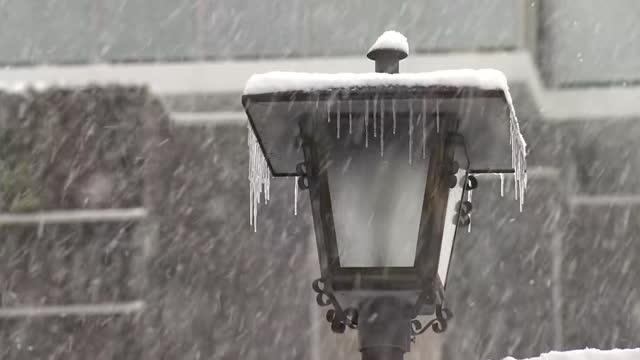 cu, frozen streetlight in blizzard, fukuoka, japan - fukuoka prefecture stock videos & royalty-free footage