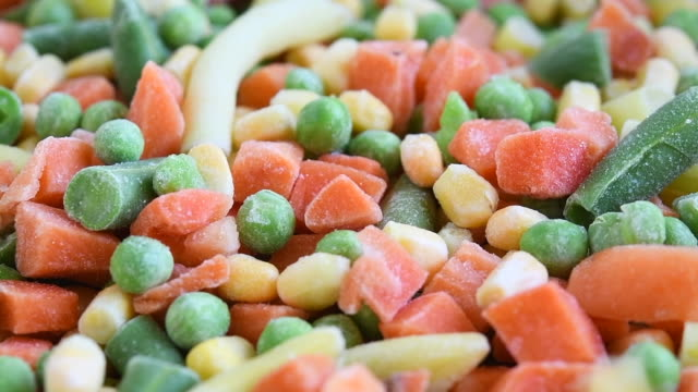 frozen vegetable medley falling in a wooden bowl, slow motion - frozen food stock videos & royalty-free footage