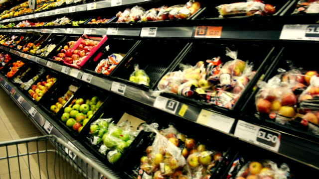 fruit and vegetable section of a supermarket - trolley stock videos and b-roll footage