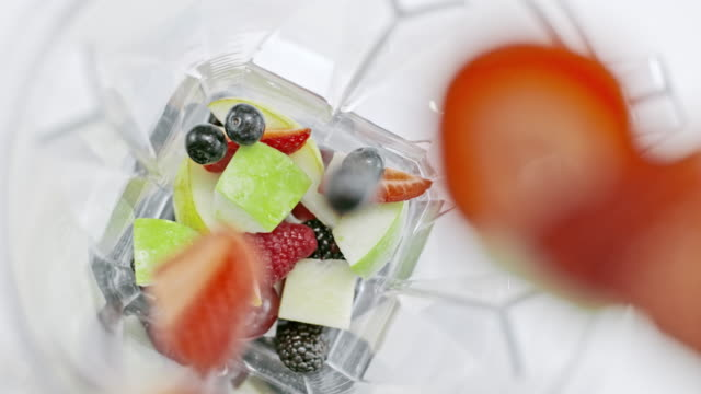 slo mo fruit being added into the blender - chopped food stock videos and b-roll footage