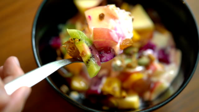 slo mo - fruit bowl for breakfast - fruit bowl stock videos & royalty-free footage