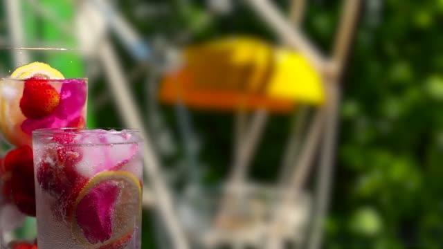 Fruit drinks on the amusement park background